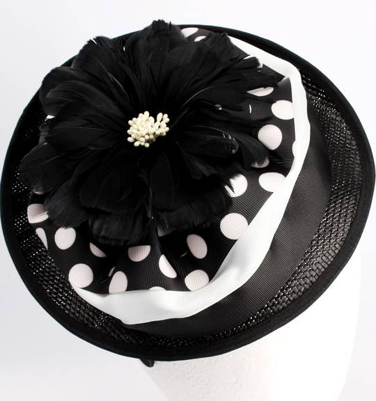 Hatinator with sinamay base,feather flower on black. Style: HS/1364