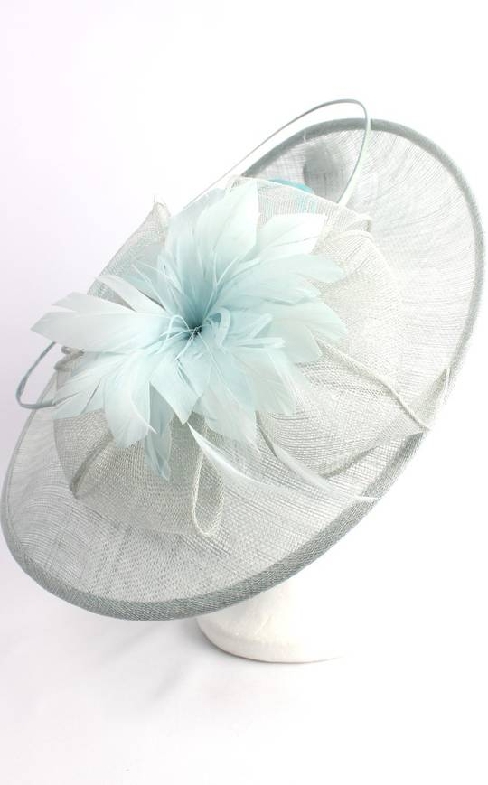 Larger round sinamay hatinator  w floral feature and circular  ice blue feather spheres STYLE: HS/3005 /BLU