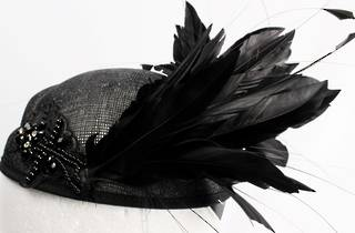 Hatinator in sinamay beeded w striking blk feathers,  black Style: HS/3015/BLK- arrives Aug